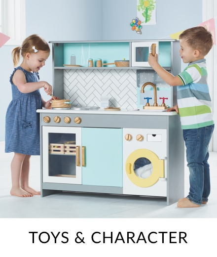 A boy and girl playing with a grey, blue and yellow wooden kitchen set.