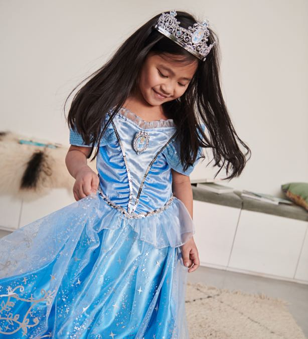 Girl wearing blue princess dress with silver crown.